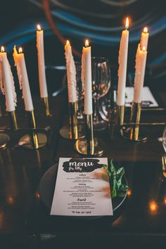 Gold candlestick centrepiece with black and white place settings for modern minimalist wedding reception   Klee Photography