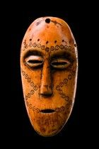"Lega ""lukungu"" masks belong to members of ""bwami""- society who already have reached the highest rank of kindi. ""Lukungu"" means ""skull"" and should be a hint that the mask is thought to remind of deceased ""kindi"" members. H: 11,5 cm"
