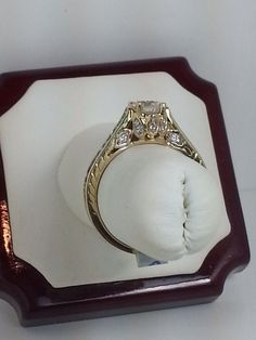 Half carat diamond ring-side view. Only $1200! There are also an estimated 40pts embellishing the ring on the sides putting the total diamond weight at .90pts