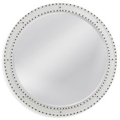 The Hosford Wall Mirror from the Breakwater Bay Company's features a circular mirror glass with a fancy polished beveled edge surrounded by a white lacquer framing with white inlays and brass riveting for a contemporary industrial appeal.