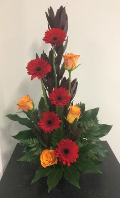 Line flower arrangement. The lines are made from the stems of roses and Transvaal Daisy's.