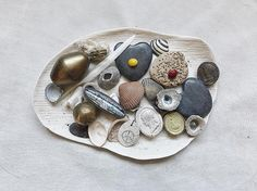 Good 'things' that resonate with me including: -Antique silver brooch inlaid with butterfly wing (inherited from mum) -Brass temple bell from Delhi with the sweetest tinkle -Coral found beach combing in the Perhentian Islands (magical place) . The value of objects... . . . #lifeimitatesart #artimitateslife #inspired #foundobjects #preciousthings #nature #sculpture #inspo #moodboard #tamaragomezstudio #collectandstyle #tamaragomezjewellery #objects  #spiritinspired #collecting #hoarder