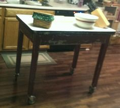 Homemade rustic kitchen island. Made from a reclaimed porcelain top table. Added locking casters and voila!