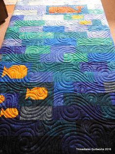 Jan's Ocean baby quilt. Digital design Harbour Wave from Mary Beth O'Halloran and Patrica Ritter – Hobbs 80/20 batt and Superior's Omni thread in Ocean blue