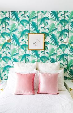 Bedroom with botanical wallpaper and pink accent pillows