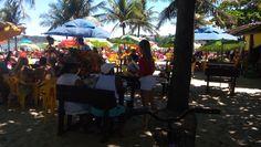 Panfletagem nos quiosques na praia da Curva da Jurema.