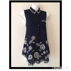 """Moulinette Soeurs navy blue cotton top, so cute! Collared with scalloped hemline and delicate embroidery embellishments. Buttons down 3/4 of the way and has cute little pocket. Color is dark navy, almost black. Excellent condition. Measures appx 27"""" long appx 19"""" across bust from armpit to armpit Anthropologie Tops"""