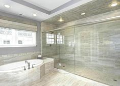 Contemporary master bathroom with oversized shower and soaking tub.