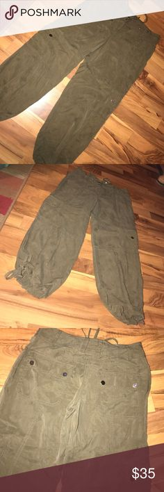 """Olive green Caché cargo joggers Super cute olive green cargo joggers by Caché. Great used condition. Has drawstring around the waist and ankles. Size 2. 15"""" flat across the waist, 25"""" inseam. Cache Pants Track Pants & Joggers"""