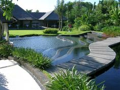 Path across a terraced pool in Bali, inspired by the rice terraces