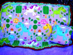 Magic Unicorn & Pillowcase fleece baby blanket, measuring 48 x 34 I found the softest of purple fleece for the reverse side. I lovingly crochet the edges with robin's egg, super duper yellow, autumn red & green. ($30.00)
