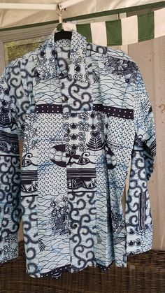 Check out this item in my Etsy shop https://www.etsy.com/listing/519473680/african-wax-print-mens-dress-shirt