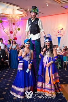 Because of course you need someone on stilts if you're doing Cirque du Soleil!! #wedding