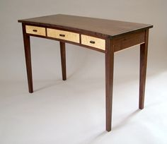 Handmade in Mount Tabor, VT by Bob Gasperetti, the walnut Concave Writing Desk with drawers is the perfect work desk in your home or office.