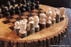 Log slices chiseled into a #rustic chess board with raw pieces