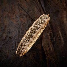 Trendy Design CZ Zircon Kada studded with White synthetic stones, with gold Polish. It Comes with Locking System.