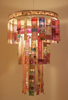 Radiance, Three Tier Chandelier by Louise Traill A three tier chandelier made from paper mache strips of handmade paper and adorned with shiny sequins, beautiful papers and colourful trimmings.  Detail of chandelier