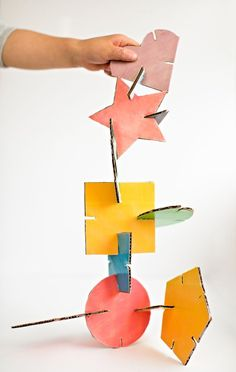hello, Wonderful - GEOMETRIC Make these fun geometric cardboard sculptures with the kids. Free printable template with 12 colored shapes included! Cardboard Sculpture, Cardboard Crafts, Maker Fun Factory Vbs, Atelier D Art, Shape Puzzles, Sculpture Projects, Craft Activities For Kids, Recycled Crafts, Art Plastique