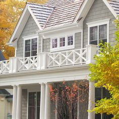 like the gray shake siding with white trim,cross railing detail