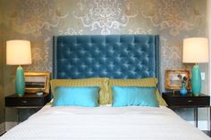 turquois eblue & gold bedroom design with blue velvet tufted wingback headboard with nailhead nail head trim, striped yellow pillows, turquoise blue silk pillows, espresso modern nightstands, blue lamps, gilt gold frames, crisp white bedding and metallic gold & gray stencil wall treatment. white yellow turquoise blue gold gray bedroom colors.