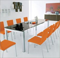 "Dining Table     AIRPORT by Calligaris of Italy.  Chrome or Satin Steel leg, glass top in several colors.  Automatic mechanism pops up glass leaves as you pull the leg out.  Cool modern design 51"" opens to 102"".  www.pomphome.com"