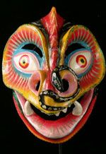 Devil Mask. Carnival, Oruro, Bolivia. Painted plastered cloth. The devil mask captures the essence of the Oruro Carnival. The devil or Supay represents the Andean pre-conquest underworld figure that was lord of the hills and transmogrified by the Christians as the Devil. This one has a snake crawling through the nose instead of horns. Traditional in construction as well as style, it is made of cloth impregnated with a mixture of glue and plaster formed over a mold.