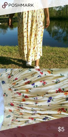 Vintage Floral Cream Skirt Beautiful long floral pleated cream skirt! With elastic waist  Size: Small but also fits a medium 100% Rayon Skirts