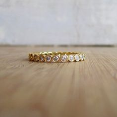 Yellow gold bezel eternity band approx. 25 1-1.5 pointer diamonds set in yellow gold eternity band $1800