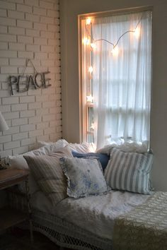 Cottage Fix blog - pillows, peace sign, and star lights