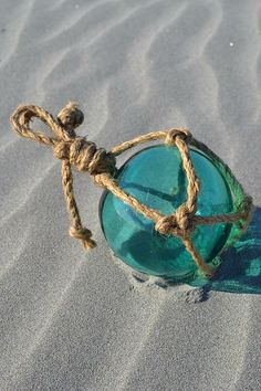 Turquoise Glass Float in the Sand - Mg Rhoades
