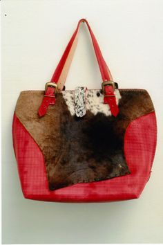This is more of an overnight bag. It is made up of dyed veg leather and nguni.