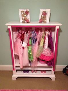 Upcycled an old dark wood display cabinet to create a fab little dressing up cupboard for my 3 year old daughter x