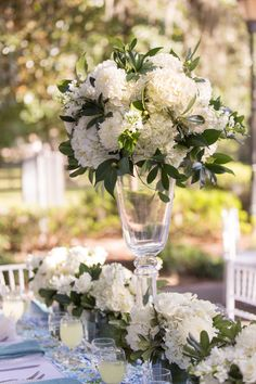 Tall Glass Centerpieces with Lush Hydrangea Arrangements.. I love the amount of greenery mixed in with these hydrangeas