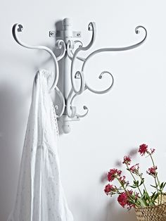 Set upon a simple antiqued white wall fixing, these three double hooks feature beautiful twists and curls and have specially rounded tops designed to not dent your clothes. A clever storage solution if you are short of space, use to hang coats in the hallway or even towels in the bathroom. Why not team with our Vintage Style Dress Rail for a beautiful vintage inspired dressing room.