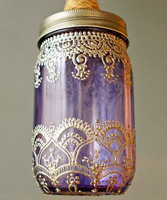 Dancer Mason Lamps: Inspired by Morocco & firefly catching. Hand painted in Henna-like detail on sea-glass colored Mason jars / http://www.dotandbo.com/