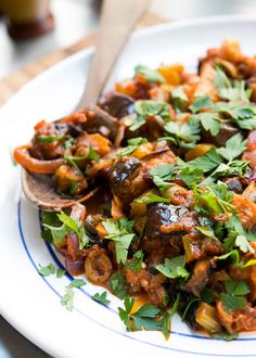 The classic Sicilian salad of eggplant and tomatoes with vinegar, olives and…