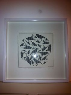 Birds hand cut out of hand made cotton paper. Artist- Laura Drayson