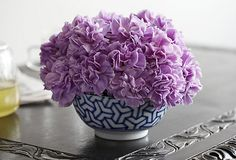 "Flower Vessels; For a versatile vessel that can easily pinch-hit as a pretty centerpiece, patterned bowl. ""It's important to make sure that the bouquet looks round and full in the bowl."