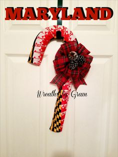Maryland Gifts; Front Door Wreath for Christmas; Maryland Pride; Candy Cane Wreath; Christmas Gift Ideas; Gift for Him; Chesapeake Bay; Maryland Flag; Maryland souveniers; holiday gifts; gift for mom; gift for coworker; christmas decorations; holiday door hanger; maryland door hanger; candy cane decor; maryland football; maryland themed wreaths; gift ideas #Maryland #christmasgift #candycane #wreaths #marylandgifts #candycanewreath #marylandthemedgift #giftideas #christmasdecor #etsygifts