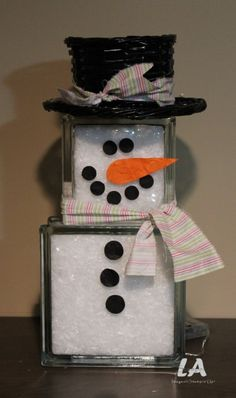 Glass Block Snowman using a Large Kraty Block on the bottom and a small Krafty Block on the top. Fill with bagged shimmery snow, glue on felt for eyes and buttons...super easy!#snowman#glassblock