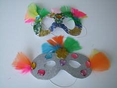 We think these Masquerade Masks are a great Birthday Party craft activity for kids!