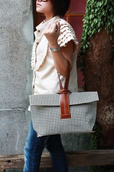The Criss-Cross Bag by Quote -- leather n canvas (houndstooth) - forget the bag...I want to know about her shirt.