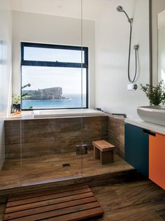 Modern beachside prefab home in Australia by Archiblox with wood-effect tiles by ariostea in the bathroom shower and tub
