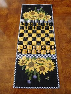 Table runner/chess or checker board approx. x Checked game board is pieced. Sunflowers are raw edge fused & stitched applique embellished with seed beads. The thistles are applique with thread sketched blossoms. The 2 bees have sheer organza w Quilted Table Runners Christmas, Table Runner And Placemats, Table Runner Pattern, Christmas Tables, Table Topper Patterns, Quilted Table Toppers, Sunflower Quilts, Sunflower Pattern, Watercolor Quilt