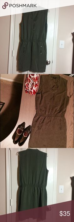 Dress It's all about details with this dress. Zippered pockets on each hip, and one at the neckline, which has a unique shape as well. This dress is olive green, even tho in a couple of photos it looks brown. Gently worn, perfect condition. Comes from a non-smoking home. This looks cute with boots and a a burgundy sweater in the Fall. But shed the sweater in the warmer weather and pair with gold jewelry and pointy-toed heels. Calvin Klein Dresses Mini