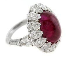 J.W. Currens Inc.    Ring in platinum featuring a 14.25 ct. unheated ruby cabochon accented with diamonds (7.97 cts. t.w.)