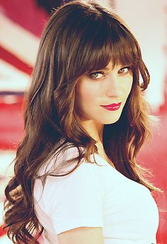Zooey Deschanel! One day when I get tired of growing my bangs out, I'll do this. Her hair always looks so pretty.