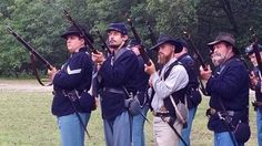 The group gave park patrons a glimpse at life as a soldier in 1861. Dressed head-to-toe in traditional wool uniforms, Company F marched field maneuvers and battled Confederate enemies between light showers of drizzling rain.