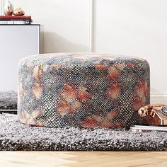 Inspired by the lustrous sheen of exotic snakes, Matthew Williamson scaled this pouf with a vibrant serpentine rainbow. Adds a lovely layer of pattern/color to any room. Dense bead filling is substantial enough for seat/ottoman/tray duty.