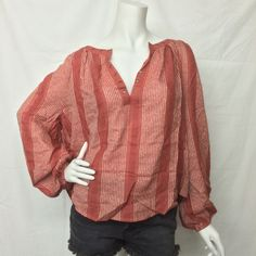 In an effortless, oversized fit this sheer blouse features metallic stripes, plunging V-neckline and metal grommet detailing. Long sleeves with elastic cuffs. 81% Rayon 19% Cotton Machine Wash Cold Import Pictured with Free People jean shorts that can be found by clicking here.